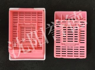 China Mid Size Tissue Embedding Cassette Pink Color Round Hole Layout Without Lid supplier